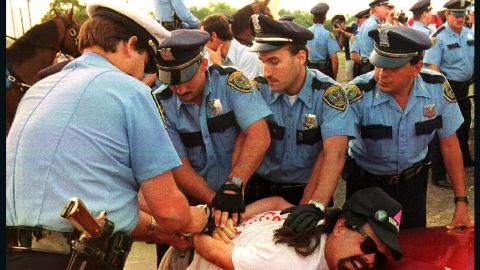 <strong>1992:</strong> Police officers at the 1992 Republican National Convention in Houston arrest a demonstrator from La Resistencia, an organization protesting acts of violence against immigrants and the deportation of illegal immigrants. The demonstrators failed to adhere to rules keeping them inside a 35-acre protest site across from the Astrodome, where convention delegates gathered.