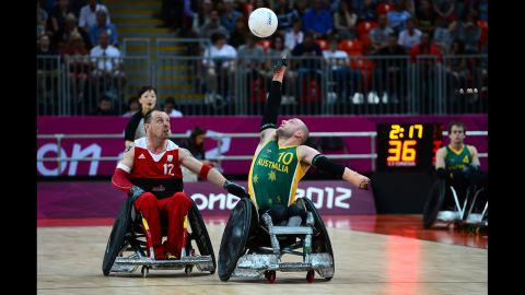 Australia's Chris Bond reaches for the ball during the mixed wheelchair rugby open match against Belgium on Friday.