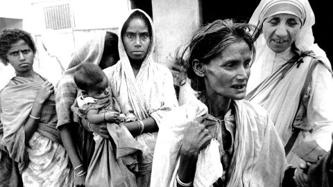 Mother Teresa, head of the Sisters of Charity, works with some of the lepers in Calcutta on December 7, 1971.