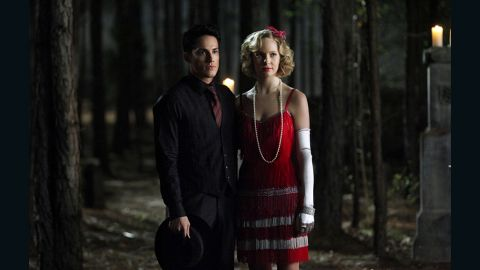 """For Mystic Falls High School's annual Decade Dances, Leverett said she dresses the human students like """"a teenager would interpret the period."""" Though Tyler (Michael Trevino) and Caroline (Accola) are supernatural beings -- he's a hybrid vampire-werewolf and she's a vampire -- they're fairly new to being undead. They didn't live through the '20s like many of the other vampires in town. Leverett likes for the centuries-old vampires to attend such events in outfits they could have pulled from """"their vintage clothing storage closet."""""""