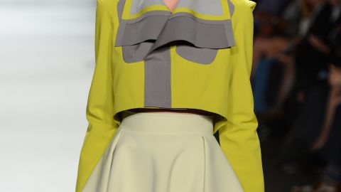 """Elena Slivnyak, a contestant on """"Project Runway,"""" showcased an edgy, modern collection, complete with green and yellow lipsticks."""