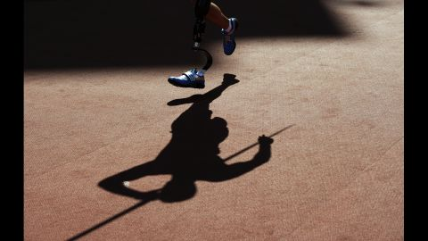 A picture shows the shadow of competitors as they compete in the men's javelin throw F42 final on Friday, September 7.