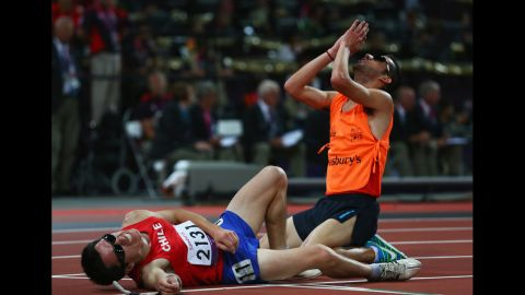 Cristian Valenzuela of Chile and guide Cristopher Guajardo react as they win gold in the men's 5000m T11 final on Friday.