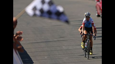 Robbi Weldon and Lynne Bessette of Canada ride in the women's cycling road race on Saturday.