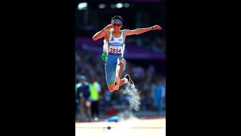Doniyor Saliev of Uzbekistan competes in the men's triple jump F12 final on Saturday.