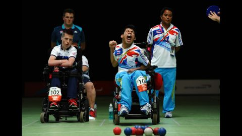Thailand's Pattaya Tadtong, right, celebrates beating Britain's David Smith, left, in the final of the boccia individual BC1 competition on Saturday.