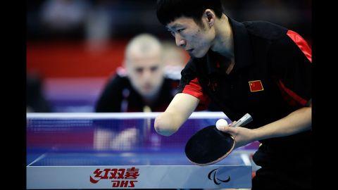 China's Yang Ge serves against Poland's Sebastian Powrozniak during the men's team table tennis Class 9-10 final on Saturday.