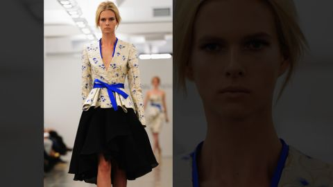 On an all-white backdrop, Carmen Marc Valvo reveals his spring line, including this cobalt and ivory number.