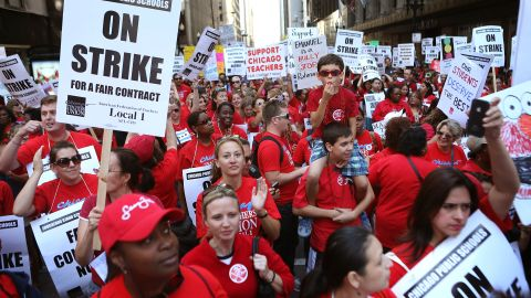 CHICAGO, IL - SEPTEMBER 10:  Thousands of Chicago public school teachers and their supporters march through the Loop and in front of the Chicago Public Schools (CPS) headquarters on September 10, 2012 in Chicago, Illinois. More than 26,000 teachers and support staff hit the picket lines this morning after the Chicago Teachers Union failed to reach an agreement with the city on compensation, benefits and job security. With about 350,000 students, the Chicago school district is the third largest in the United States.  (Photo by Scott Olson/Getty Images)