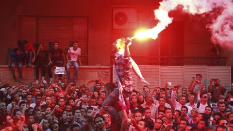 People shout slogans and light flares in front of the U.S. embassy during a protest against what they said was a film being produced in the United States that was insulting to the Prophet Mohammad, in Cairo September 11, 2012. Egyptian protesters scaled the walls of the U.S. embassy in Cairo on Tuesday and some pulled down the American flag during the protest, witnesses said. REUTERS/Amr Abdallah Dalsh ( EGYPT - Tags: POLITICS CIVIL UNREST RELIGION ENTERTAINMENT) REUTERS /AMR ABDALLAH DALSH /LANDOV
