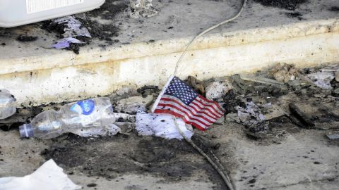 A small American flag is seen in the rubble on September 12.