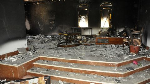 Smoke and fire damage is evident inside a building on September 12.