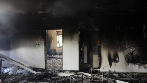 Half-burnt debris and ash cover the floor of one of the U.S. mission buildings on September 12.