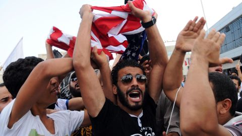 Image #: 19362329    epa03395815 A group of protesters shout slogans during a demonstration outside the US Embassy, in Tunis, Tunisia, 12 September 2012. About one hundred people demonstrated in front of the US embassy for the second time in 24 hours on 12 September. Dozens of demonstrators held a sit-in to protest a film that triggered a deadly attack on a US consulate in Libya on 11 September, according to media reports. The demonstrators waved black jihadist flags and carried signs with slogans condemning a US-produced film deemed insulting to the prophet Mohammed, Radio Shems reported.  EPA/STR /LANDOV