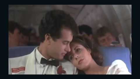 """After more than 20 years of marriage, Tom Hanks and Rita Wilson are still going strong. The pair, who appeared together in 1985's """"Volunteers,"""" <a href=""""http://www.usmagazine.com/celebrity-news/news/awww-tom-hanks-rita-wilson-caught-on-kiss-cam-201253"""" target=""""_blank"""" target=""""_blank"""">smooched for the Kiss Cam</a> at a Los Angeles Kings game in 2012."""