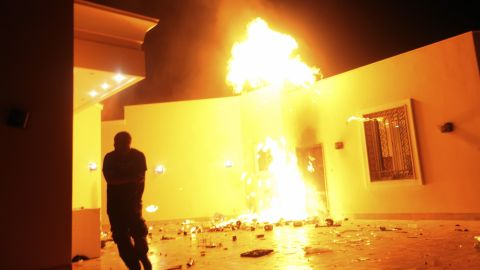 Flames erupt outside of a building in the consulate compound on Tuesday.