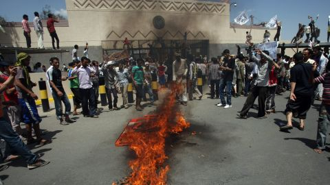 Yemeni protesters gather around fire during a demonstration outside the US embassy in Sanaa  over a film mocking Islam on September 13, 2012. Yemeni forces managed to drive out angry protesters who stormed the embassy in the Yemeni capital with police  firing warning shots to disperse thousands of people as they approached the main gate of the mission.   AFP PHOTO/MOHAMMED HUWA        (Photo credit should read MOHAMMED HUWAIS/AFP/GettyImages)
