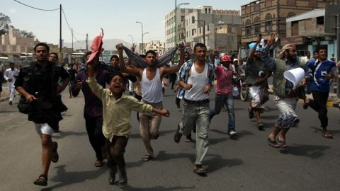 Protesters chant during a march to the U.S. Embassy in Sanaa, Yemen, on Thursday, September 13. One protester was killed in clashes when Yemeni security forces dispersed hundreds of demonstrators who gathered around and inside the U.S. Embassy in Sanaa.