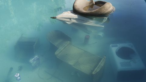 A lounge chair and umbrella float in the swimming pool of the U.S. mission on September 13.