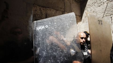 Israeli police officers stand behind their shields during clashes with stone-throwing Palestinian protesters in a demonstration against an anti-Islam film in front of the Dome of the Rock in Jerusalem's Old City on Friday.