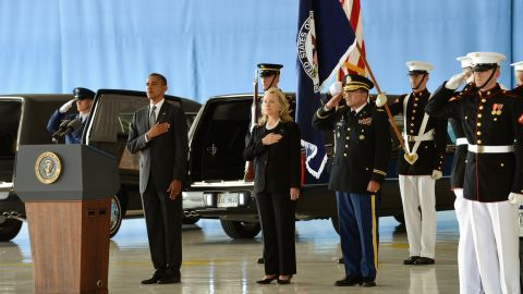 Obama and Clinton stand at Andrews Air Force Base as the bodies of the four Americans killed are returned on September 14.