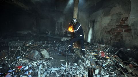 A Tunisian firefighter works inside a destroyed school building in the grounds of the American school in Tunis, Tunisia, on Saturday. Four people were killed and almost 50 injured in an attack on the U.S. Embassy in Tunis the day before by protesters angry over an anti-Islam film, the health ministry said.