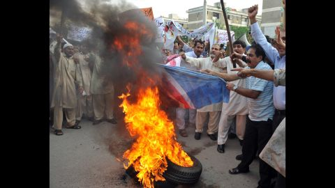 Pakistani Muslims burn a U.S. flag during a protest rally in Islamabad on Saturday. The Pakistani Taliban on Saturday issued a call to young Muslims worldwide and within the country to rise up against an anti-Islam movie.