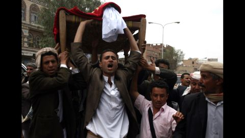 Mourners shout slogans during the funeral of a protester who was killed two days ago during clashes with security forces at the U.S. Embassy in Sanaa, Yemen, on Saturday . According to media reports, at least four people were killed when hundreds of Yemeni protesters stormed the embassy on Wednesday.