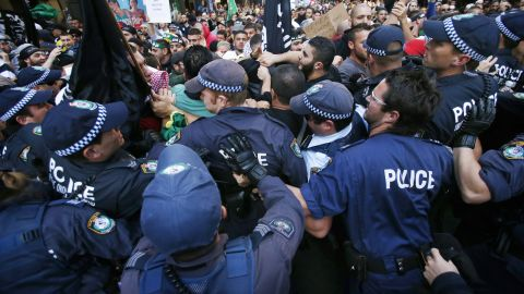 Protesters clash with police on a street in Sydney's central business district on Saturday.
