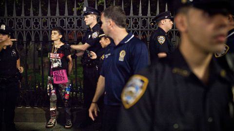 An Occupy Wall Street protester is arrested by police on Broadway after a march from Washington Square Park to New York's financial district on Saturday, September 15.