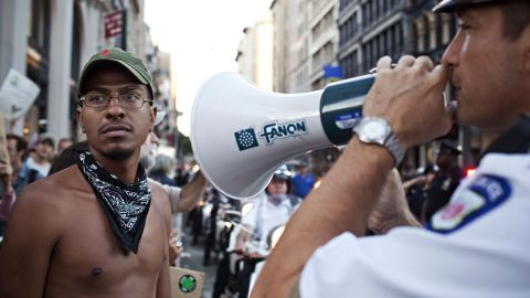 A police officer gives orders to Occupy Wall Street protesters on Saturday.