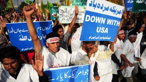Pakistani protestors hold banners and shout anti-U.S. slogans in Karachi on Sunday.