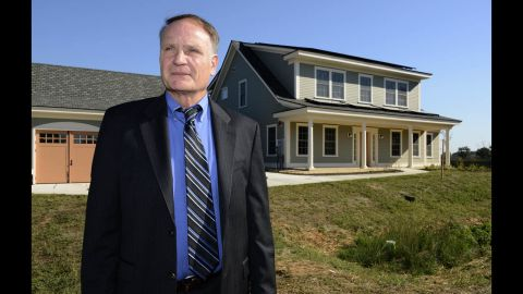 Hunter Fanney, chief of the Energy and Environment Division of the National Institute of Standards and Technology's Engineering Laboratory, stands outside the Net-Zero Energy Residential Test Facility.