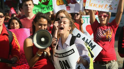 Students picket with Chicago teachers outside Lane Tech College Prep High School on Tuesday, September 11.