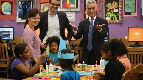 """Chicago Mayor Rahm Emanuel, right, visits schoolchildren at Woodson Regional Library on Monday. The library is one of 78 public libraries in the city serving as """"safe havens"""" for students who are not in school because of the strike."""