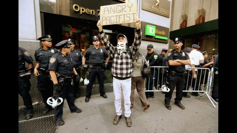 A protester affiliated with Occupy Wall Street stands near Wall Street on Monday.