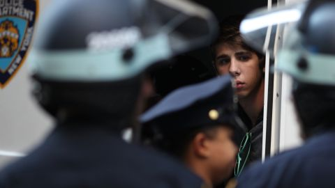 A protester looks out from a police van after being arrested on Monday.