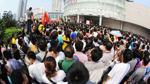 Chinese protesters gather outside a JUSCO, a Japanese department store, in Qingdao, northeast China's Shandong province.