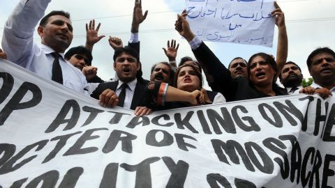 Pakistani lawyers shout anti-American slogans as they march Monday in Lahore.