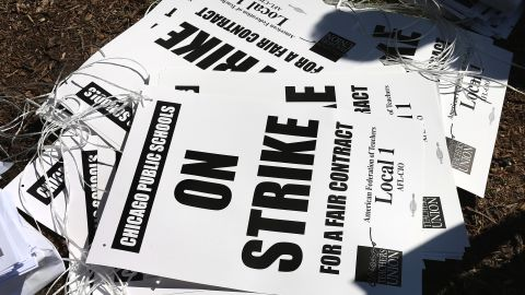 Strike posters are left on the ground in Union Park on Saturday. More than 26,000 teachers and support staff walked off their jobs on September 10 after the union failed to reach an agreement with the city on compensation, benefits and job security.