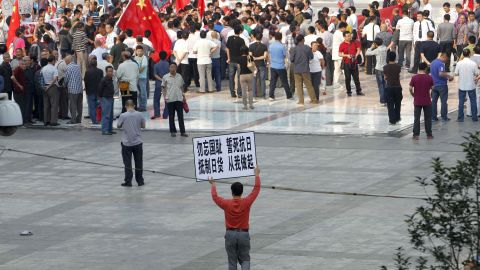 Chinese demonstrators protest on the streets in Zhengzhou, Henan province, on September 18, carrying on anti-Japanese rallies from the weekend.