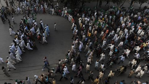 Pakistani Sunni Muslims march during a protest against the anti-Islam movie in Peshawar on Tuesday. Police used tear gas to disperse a crowd of more than 2,000 protesters trying to reach the U.S. Consulate in northwest Pakistan.