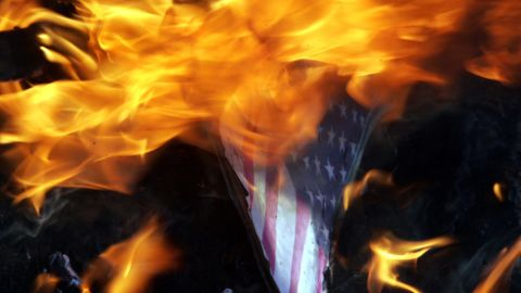 """Indian Muslims burn an American flag with a picture of U.S. President Barack Obama as they protest against a U.S.-made anti-Islam film on Tuesday, September 18, near the U.S. Consulate in Chennai. About 5,000 people have gathered in front of the building. Google India has already blocked access to the film, which the government has condemned as """"offensive."""""""