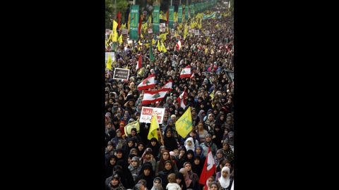 """Supporters of Lebanon's Hezbollah group march during a rally in southern Beirut to denounce the film mocking Islam on Monday, September 17. Hezbollah chief Hassan Nasrallah, who made a rare public appearance at the rally, has called for a week of protests across the country over the film, describing it as the """"worst attack ever on Islam."""""""