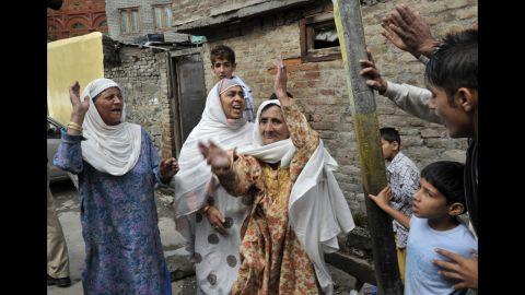 Muslim women shout Islamic slogans in Srinagar on Tuesday.