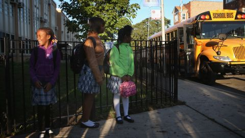 Students at Frazier International Magnet School wait outside before the start of classes Wednesday. Teachers and students had been out of school since the strike began on September 10.