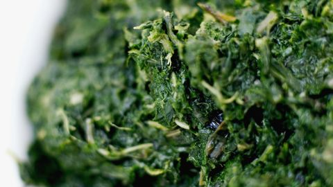 """Spinach is a great source of iron, which is a key component in red blood cells that fuel our muscles with oxygen for energy. But researchers in Sweden identified another way in which these greens might keep you charged: Compounds found in spinach actually <a href=""""http://www.sciencedaily.com/releases/2011/02/110201122226.htm"""" target=""""_blank"""" target=""""_blank"""">increase the efficiency of our mitochondria</a>, the energy-producing factories inside our cells. That means eating a cup of cooked spinach a day may give you more lasting power on the elliptical machine (or in your daily sprint to catch the bus)."""
