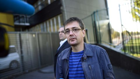 French satirical weekly Charlie Hebdo's publisher, known only as Charb, answers to journalists, on September 19, 2012 in Paris, in front of the headquarters, some hours after the release of the latest issues, which features several cartoons of the Prophet Mohammed.