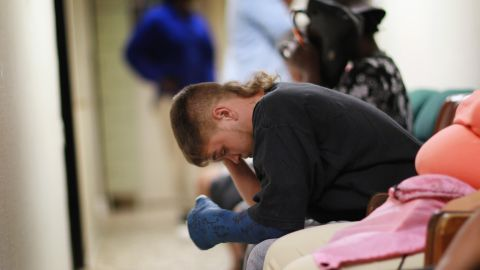 A young man waits to apply for food stamps at the Cooperative Feeding Program in Fort Lauderdale, Florida in February 2011.