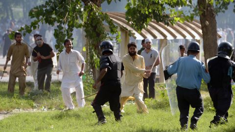 Pakistani Muslim demonstrators clash with police Friday during a protest near the U.S. consulate in Islamabad.